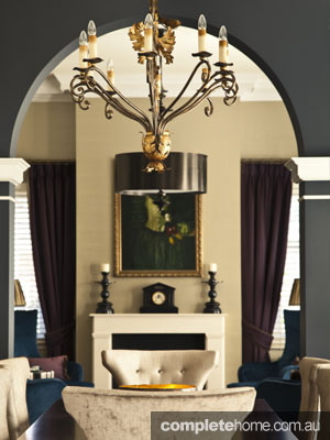 Opulent Interior Design - arched doorway and dining table