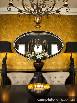 Opulent Interior Design - gold wall and chandelier