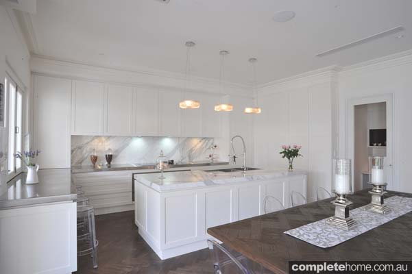 classical kitchen ideas with a gloss white finish and stone floors