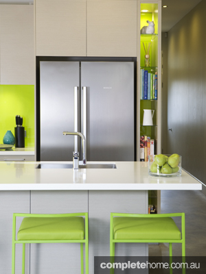 bright kitchen design ideas with a gloss white finish and stainless steel appliances