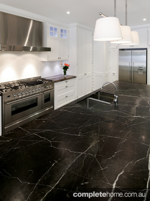 classic kitchen design with marble benchtop and stainless steel appliances