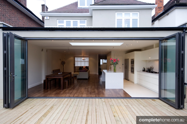 standing on the outside looking in - with timber throughout, this large living area looks even larger with timber boards continuing into decking.