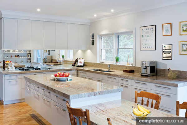 kitchen ideas combining timber elements with marble and gloss white cupboards