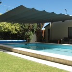 Cool your outdoor entertaining area with a retractable shade system