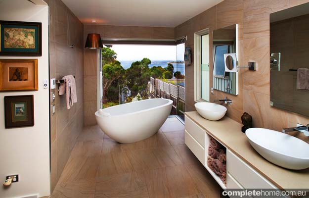 This contemporary satin-finish bathroom is a retreat for its owners — made more special by the breathtaking backdrop of the Tasmanian landscape.