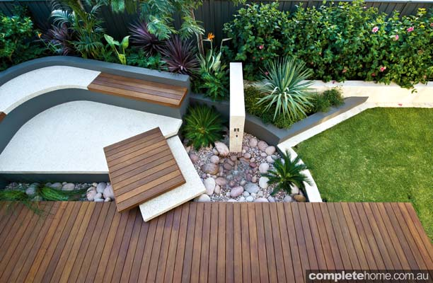 Curves are a great way to join different angles, and in this garden, the broad curve that embraces the back left-hand corner, combined with the rectangles, gives the design a sense of movement that is especially apparent from upstairs.