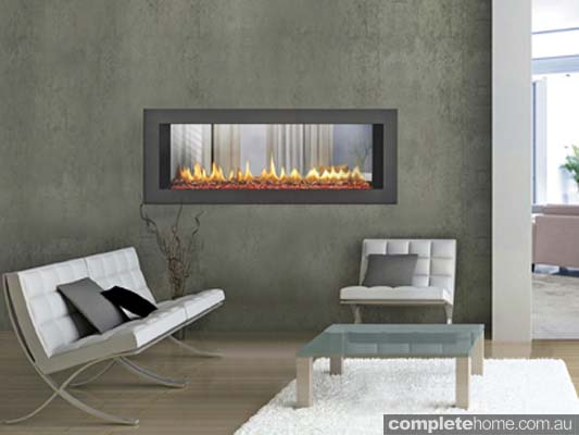 If you want to make a real design statement with your choice of heating, look towards see-through gas fireplaces.