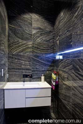 black_marble sophisticated bathroom