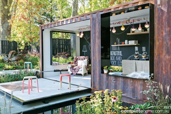 Shipping container placed in garden with lift up door