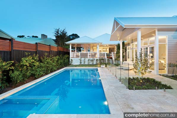 Outdoor pool with glass pool fencing