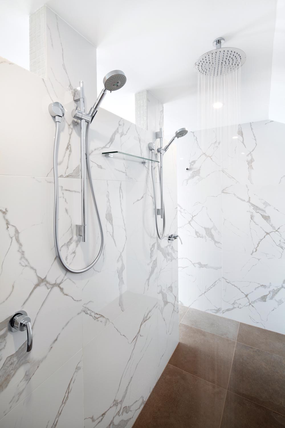 The gorgeous mosaic-tiled wall, which adds to the glamorous appeal of the bathroom.