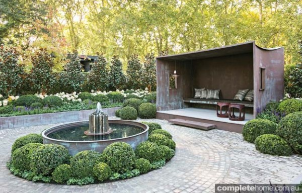 Garden with stone shafted pond