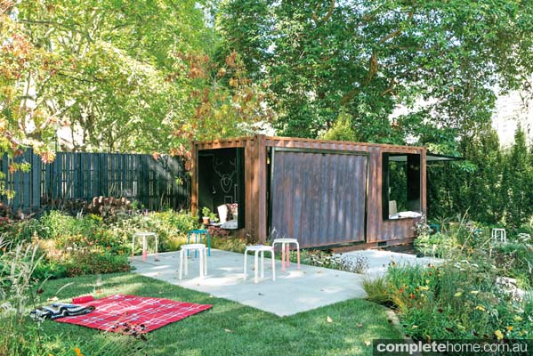 Garden with outdoor room made with a shipping container