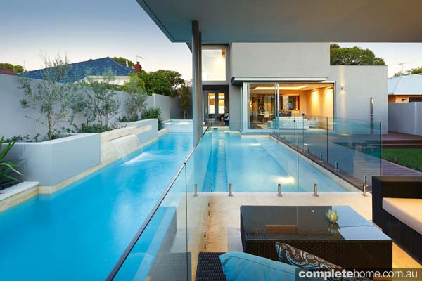 Pool design with glass fencing