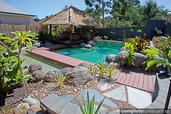 Backyard pool decked fencing and balinese hut