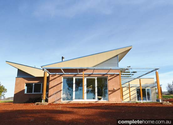 light-filled interiors and the fabulous roof line front house view