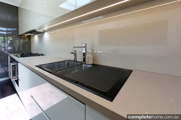 Gloss and mirrored surfaces help to reflect space and light in tight areas.