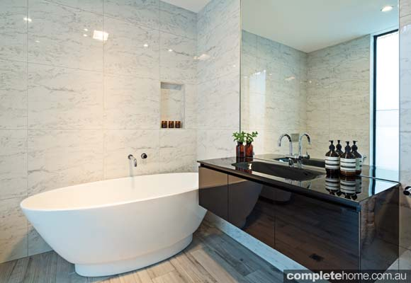 Originally a laundry and simple wetsuit shower, we moved the laundry elsewhere and created this large, clean, crisp and cool bathroom.