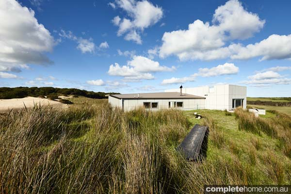 Whale house ourdoor view built on a sand dune area