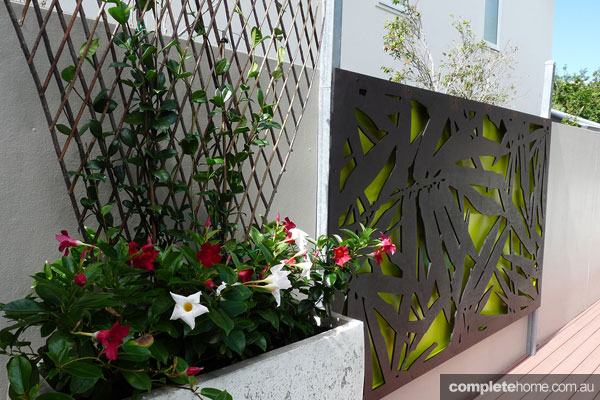 Creating spaces with decorative outdoor screens completehome for The range garden screening