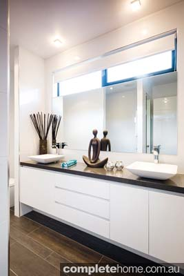 Space is luxury and here, the plan includes a private shower with a ceiling-mounted shower rose, a shower rail and toilet tucked behind a nib wall.