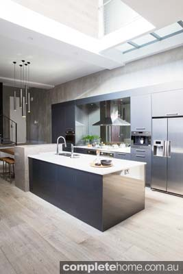 The styles adopted in this kitchen create a seamless flow from the kitchen to the living space.