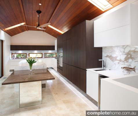 Embracing neutral and warm tones, this kitchen is practical, simplistic and inviting.