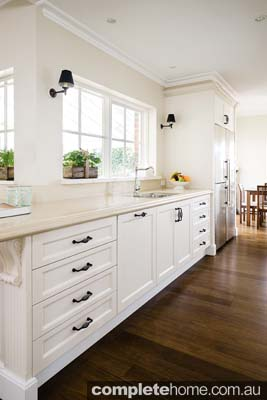 This kitchen provides a wonderful cooking area, and doubles as a functional entertainment area.