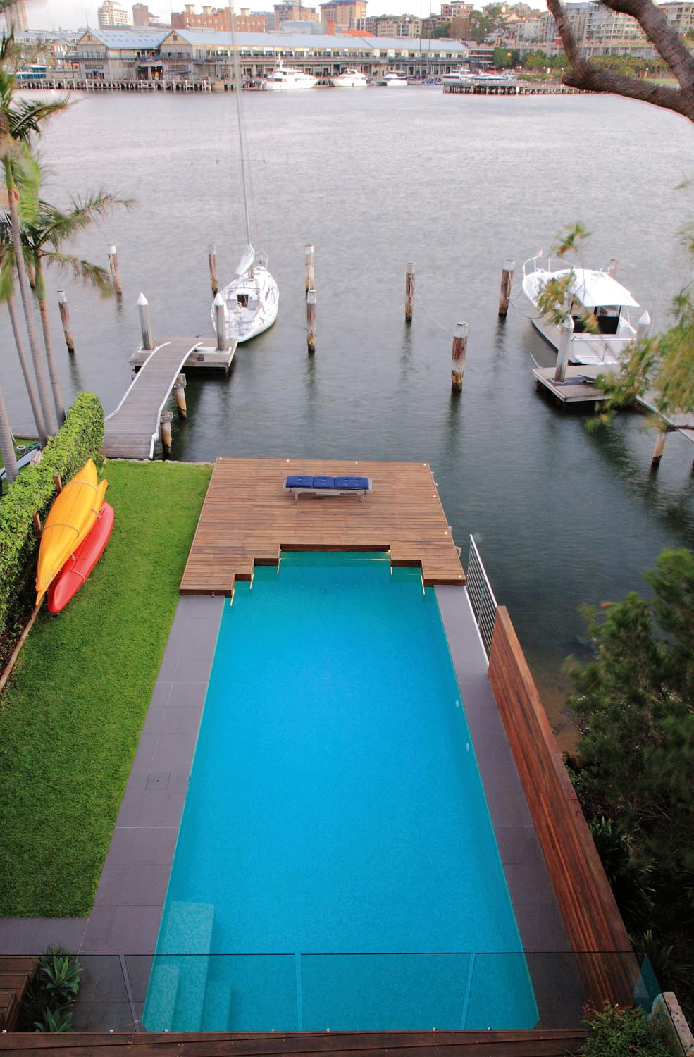 A simple pool next to a wharf and a boat
