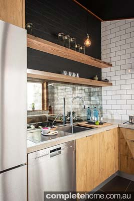 This difficultly-shaped kitchen was given a total facelift, embracing rustic and industrial design elements.