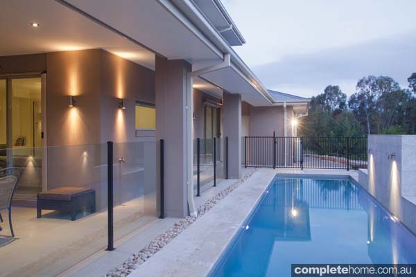 This pool is a breathtaking example of modern pool design partnered with a new-home construction.