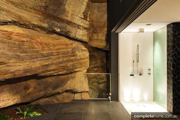 Perched against a rocky cliff face, this home embraces its surroundings and captures nature's beauty in its entirety