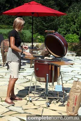 A multi-featured ceramic barbecue designed to offer outdoor cooks maximum versatility