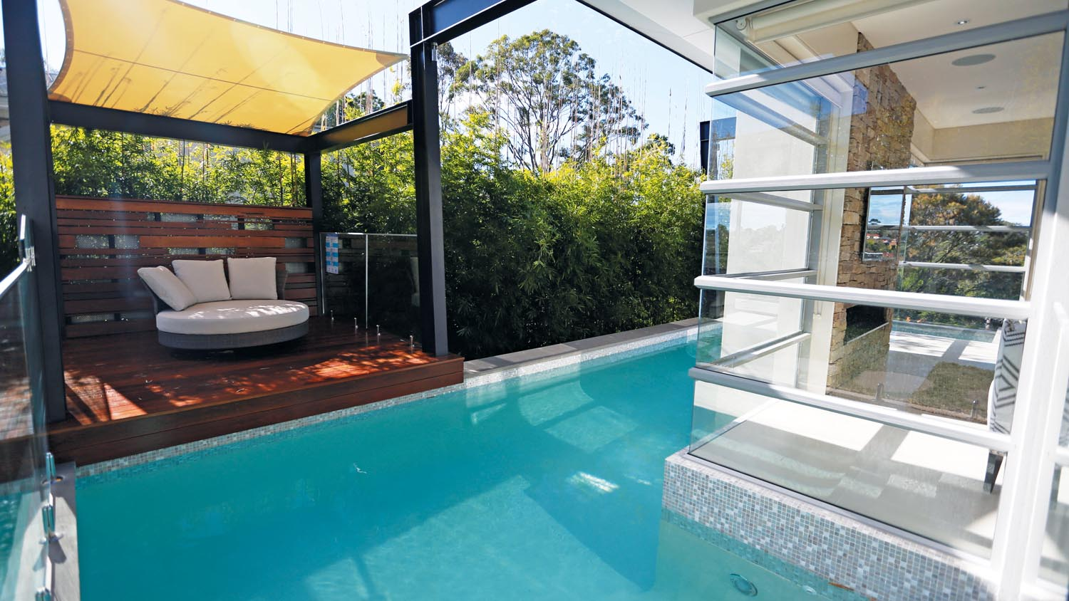 This pool wraps closely around the contemporary house, creating a perfect resort look