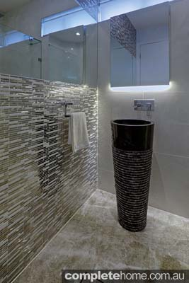 With a luxurious hotel appeal, this Creative Bathrooms design is anything but ordinary.