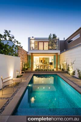 Complete with a glass-fenced outdoor eating area, this backyard is centred around the stunning swimming pool, with just enough room to relax by the water.