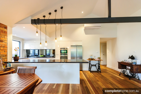With gourmet good looks and a functional design, this spacious kitchen by Mint Kitchens serves both family and guests.