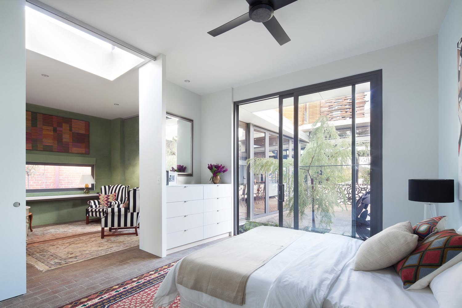 The bedrooms, as well as the rest of the house, centre on a courtyard with moveable glass walls