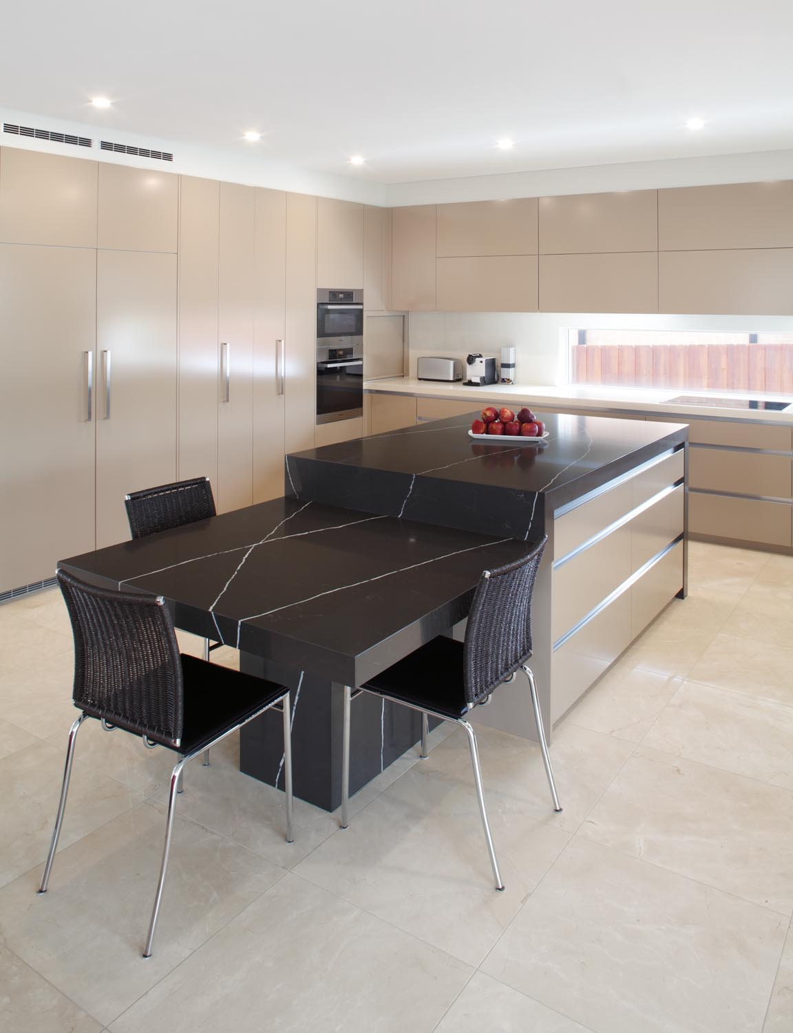 Functional kitchen with hidden laundry