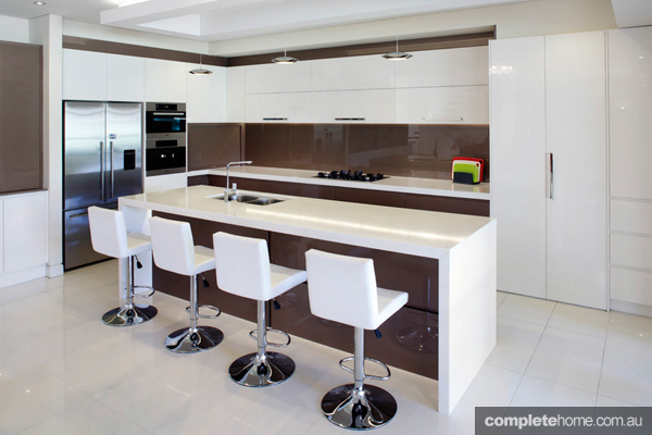 With sleek and sculptural forms, this kitchen has clean lines and a modern edge