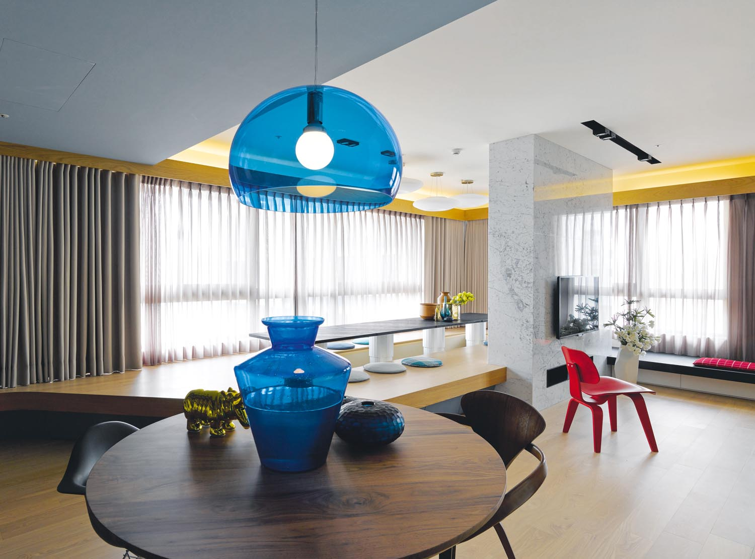 Blue accessories add depth and ambience to the neutral space