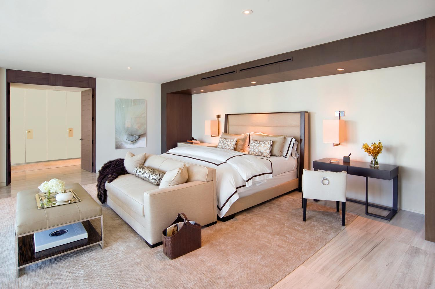 A lounge at the foot of the bed makes the ideal place to relax before a good night's sleep