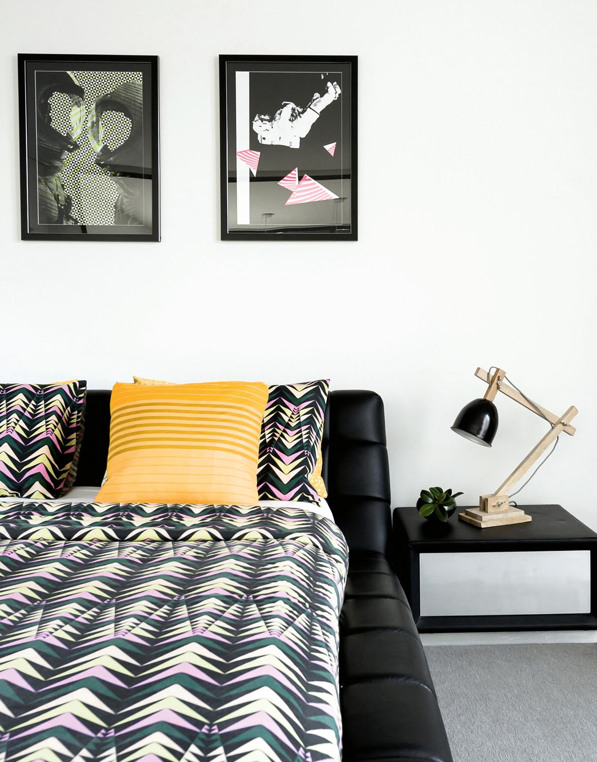 Strong contrasts and bold prints maintain the modern style in the master bedroom