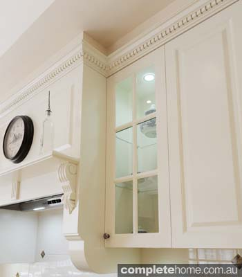 With a custom-built mantel and cap moulding, this kitchen is given added flair - and its all in the finer details