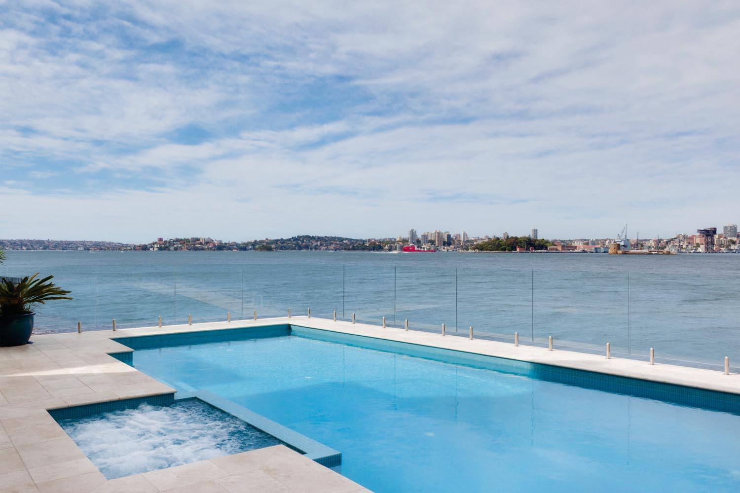 Frameless glass fencing creates the perfect effect for this harbourside pool