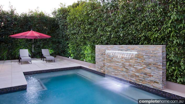 The patio and entertaining area are surrounded by glass fencing, giving the backyard a seamless flow from the house out to the pool area, while enhancing safety and helping to make the space feel larger.