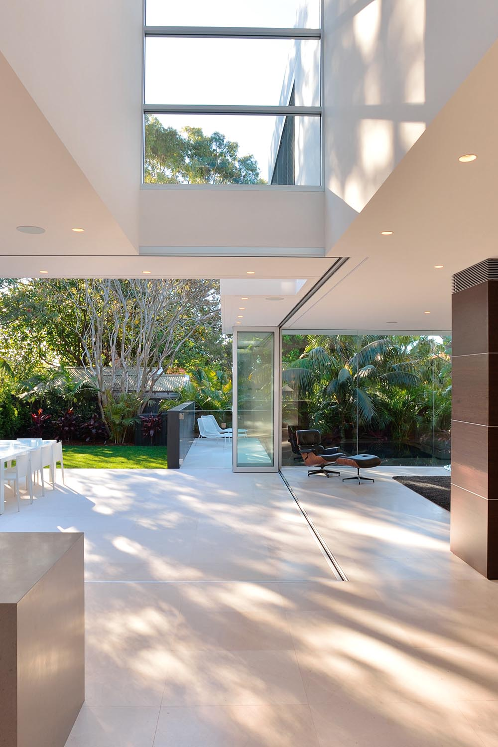 The ground floor can easily become an alfresco entertaining space with the folding glass windows