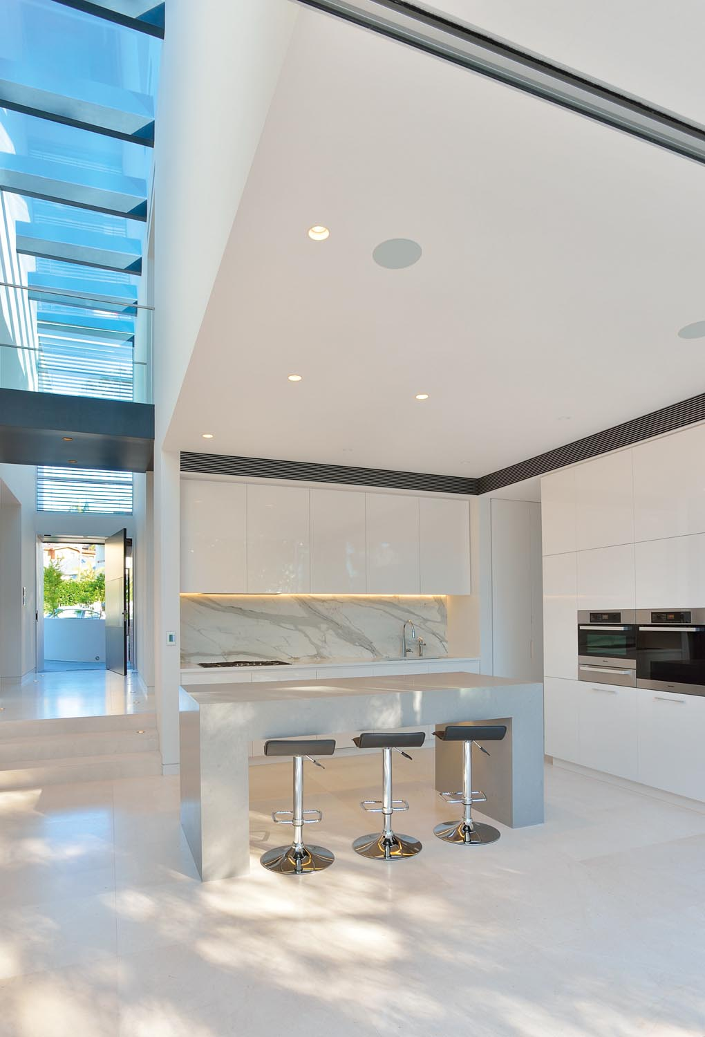 Clean and simple, the kitchen provides room  for cooking, working and entertaining