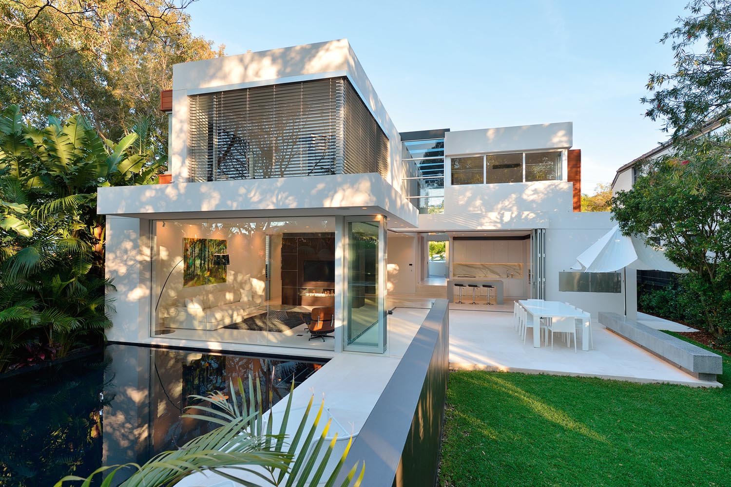 The rear of the home was designed to sit into its leafy surrounds
