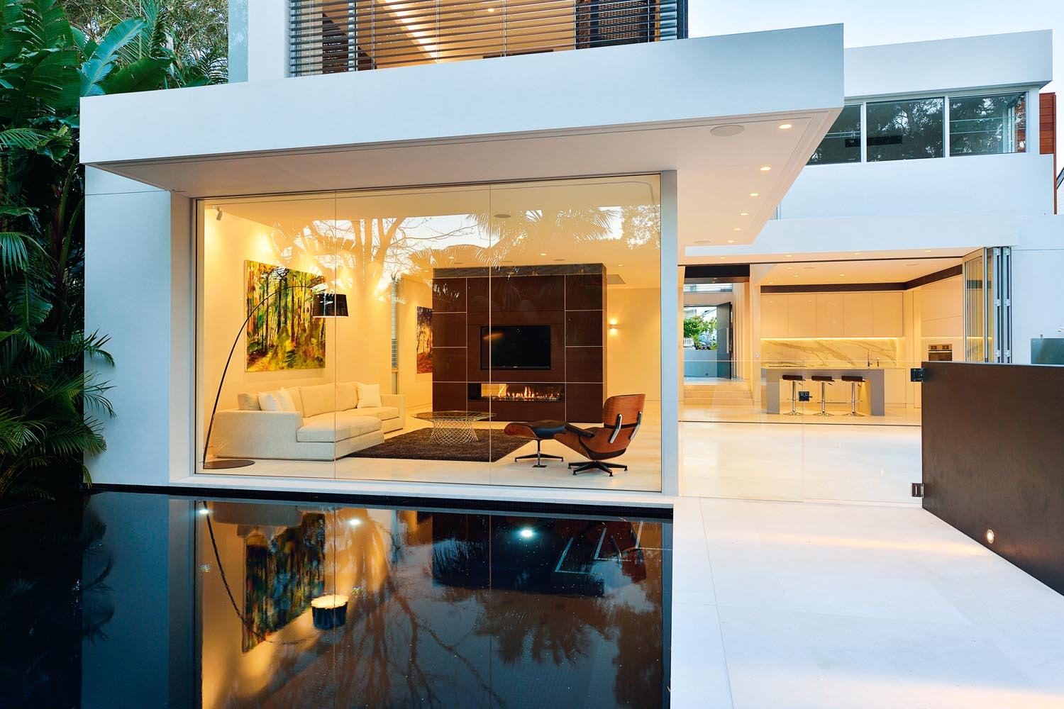 The living and dining areas lead seamlessly out to the pool and outdoor entertaining area
